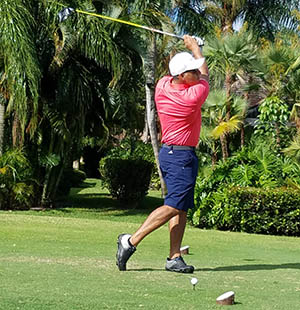 Man playing golf at a charity event