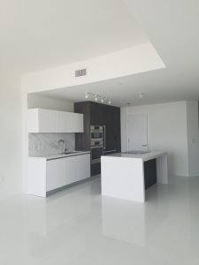 White Kitchen Space with Island